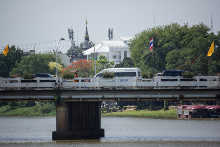 nawarat bridge: CHIANG MAI, THAILAND -MAY 10 2017:  Nawarat Bridge across Ping River. Bridge made from cement. Open in 1967. Editorial