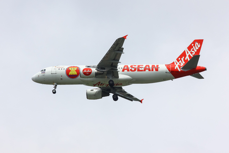 abe: CHIANGMAI , THAILAND- SEPTEMBER 24 2014: HS-ABE Airbus A320-200 of Thaiairasia. Asean Paint of Aircraft. landing to Chiangmai airport from Phuket.