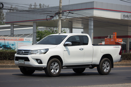 CHIANG MAI, THAILAND -APRIL 10 2017: Private Pickup Truck Car Toyota Hilux Revo. On road no.1001, 8 km from Chiangmai city. Editorial