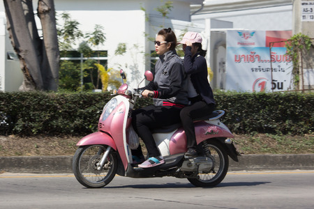 CHIANG MAI, THAILAND -JANUARY 23 2017: Private Honda Automatic Scooter Scoopy i Motorcycle. On road no.1001, 8 km from Chiangmai Business Area.