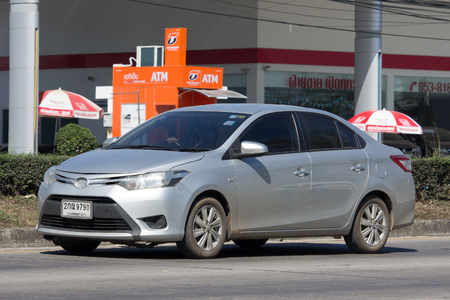 toyota: CHIANG MAI, THAILAND -JANUARY 26 2017: Private City Car Toyota Vios. Four door subcompact sedan produced by the Japanese manufacturer Toyota. On road no.1001 8 km from Chiangmai city.
