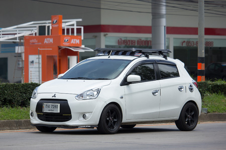 a mirage: CHIANG MAI, THAILAND - JULY 7 2017: Private Eco car Mitsubishi Mirage. On road no.1001 8 km from Chiangmai Business Area.