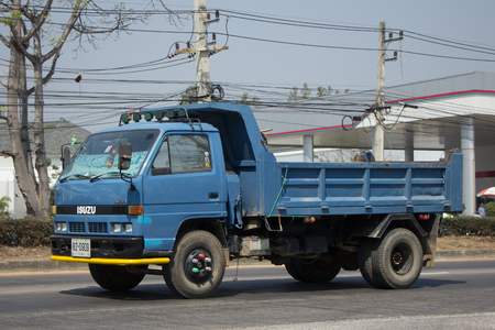 moving truck: CHIANG MAI, THAILAND -FEBRUARY 27 2017: Private Isuzu Dump Truck. On road no.1001 8 km from Chiangmai Business Area. Editorial