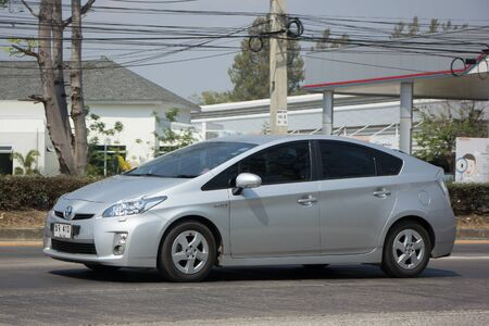 CHIANG MAI, THAILAND -FEBRUARY 27 2017: Private car Toyota Prius Hybrid System. On road no.1001 8 km from Chiangmai Business Area. Editoriali