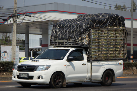 CHIANG MAI, THAILAND -FEBRUARY 27 2017: Private Pickup Truck Car Toyota Hilux Vigo. On road no.1001, 8 km from Chiangmai city. Editorial
