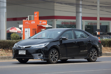 toyota: CHIANG MAI, THAILAND -MARCH 4 2017: Private car, Toyota Corolla Altis. On road no.1001, 8 km from Chiangmai city.