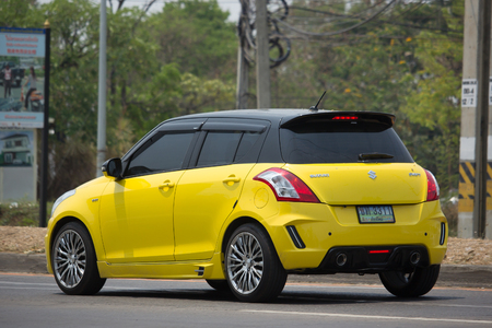 CHIANG MAI, THAILAND -MARCH 4 2017: Private Eco city Car Suzuki Swift. Photo at road no.121 about 8 km from downtown Chiangmai, thailand.