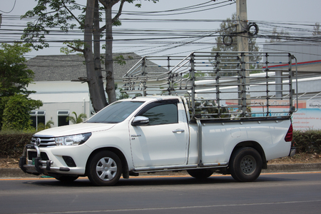 CHIANG MAI, THAILAND -MARCH 4 2017: Private Pickup Truck Car Toyota Hilux Revo. On road no.1001, 8 km from Chiangmai city. Editorial
