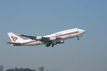747 400: CHIANGMAI , THAILAND- JANUARY 12 2008: HS-TGA Boeing 747-400 of Thaiairway. Takeoff from Chiangmai airport to Bangkok Suvarnabhumi, thailand.