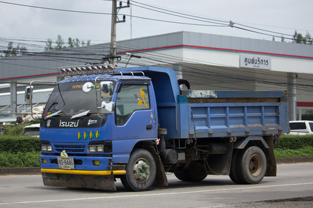 moving truck: CHIANG MAI, THAILAND - JULY 24  2017:  Private Isuzu Dump Truck. On road no.1001 8 km from Chiangmai Business Area.