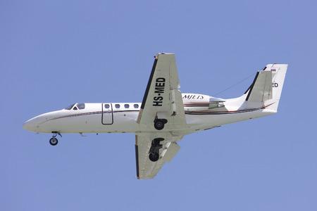 bravo: CHIANGMAI , THAILAND -FEBRUARY 5 2014: HS-MED Cessna 550 Citation Bravo of MJets. Charter flight service around Thailand. landing to Chiangmai airport. Editorial