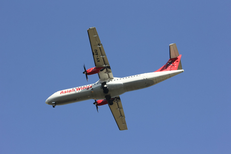 CHIANGMAI , THAILAND- FEBRUARY 5 2014: XY-AIU ATR72-200 of Asian wings. landing to Chiangmai airport from Mandalay ( Myanmar ).