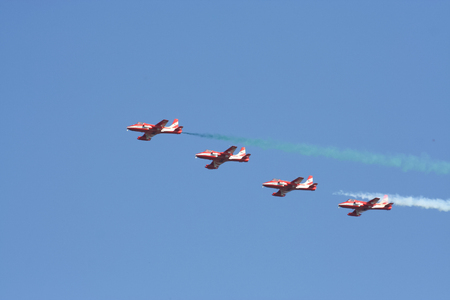 CHIANG MAI , THAILAND - DECEMBER 14 2007: HAL HJT-16 Kiran of Surya Kiran, Aerobatics demonstration team of the Indian Air Force. HJT-16 is an Indian two-seat intermediate jet trainer built by Hindustan Aeronautics Limited. Fly Over Chiangmai Sky.