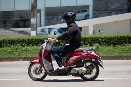 CHIANG MAI, THAILAND - JULY 27  2017: Private Honda Automatic Scooter Scoopy i Motorcycle. On road no.1001, 8 km from Chiangmai Business Area.