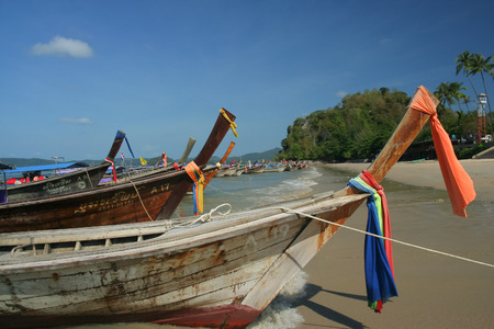 KRABI, THAILAND- MARCH 17 2009: Longtail ship at Ao nang beach. Longtail for travel to Phiphi island, Krabi. thailand.