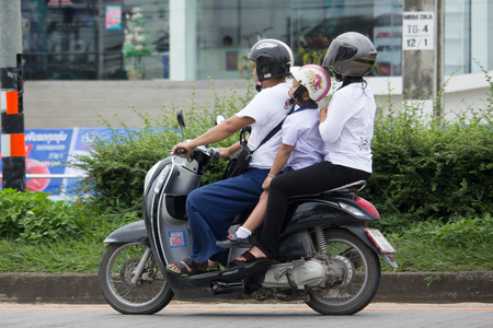 CHIANG MAI, THAILAND - AUGUEST 29  2017:  Private Honda Automatic Scooter Scoopy i Motorcycle. On road no.1001, 8 km from Chiangmai Business Area.