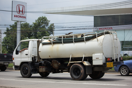 wetting: CHIANG MAI, THAILAND - AUGUEST 11  2017: Private old  water Tank Truck. Photo at Road No.121 about 8 Km from Chiangmai city.