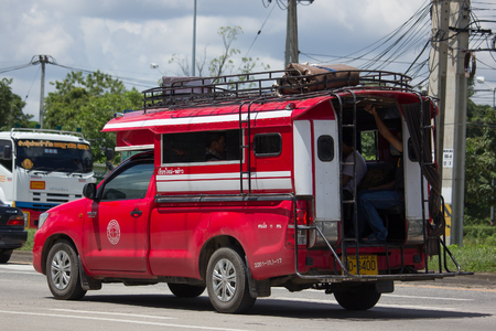 CHIANG MAI, THAILAND - AUGUST 22  2017: Orange mini truck taxi chiangmai, Service between city and Phrao district. Photo at road no.1001 about 8 km from downtown Chiangmai, thailand.