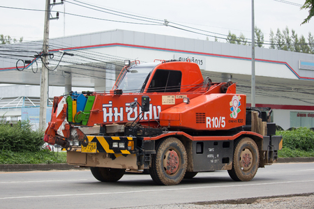 delivery service: CHIANG MAI, THAILAND - AUGUST 29  2017:  Crane Truck of Nim See Seng Transport 1988 company. On road no.1001, 8 km from Chiangmai city.