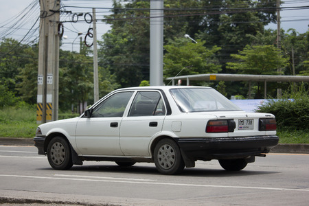 old photo: CHIANG MAI, THAILAND - AUGUST 29  2017: Private Old car, Toyota Corolla. Photo at road no 121 about 8 km from downtown Chiangmai, thailand.