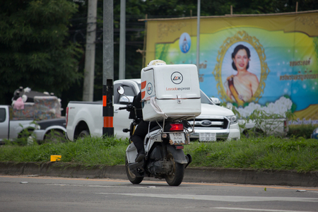 heavy industry: CHIANG MAI, THAILAND - AUGUST 29  2017: Lazada Express and Logistics Mini Container Motorcycle. Photo at road no 121 about 8 km from downtown Chiangmai, thailand.