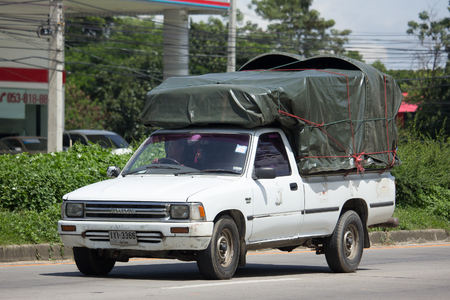 CHIANG MAI, THAILAND -SEPTEMBER 5 2017: Private old Pickup car, Toyota Hilux Mighty X. On road no.1001, 8 km from Chiangmai city. Editorial
