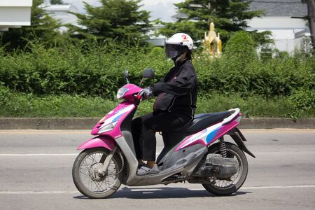 CHIANG MAI, THAILAND -SEPTEMBER 5 2017: Private Scooter Motorcycle, Yamaha Mio.  Photo at road no.121 about 8 km from downtown Chiangmai, thailand.