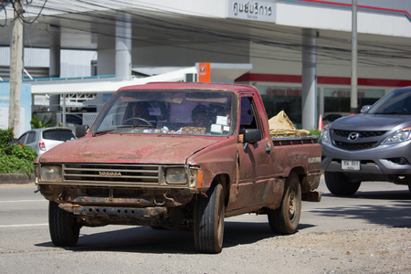 CHIANG MAI, THAILAND -OCTOBER 6 2017: Private old Pickup car, Toyota Hilux Mighty X. On road no.1001, 8 km from Chiangmai city. Editorial