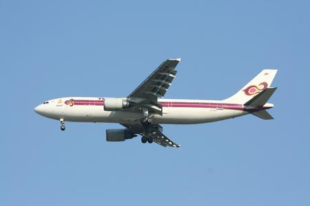 CHIANGMAI , THAILAND - CIRCA 2007: HS-TAA Airbus A300-600 of Thaiairway. Landing to Chiangmai airport from Bangkok Suvarnabhumi.