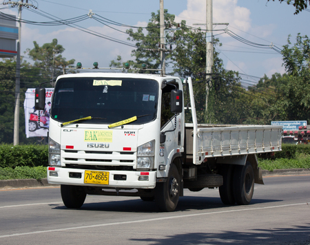 CHIANG MAI, THAILAND -NOVEMBER  14 2017: Eak Logistic Isuzu Cargo Truck. Photo at road no.1001 about 8 km from downtown Chiangmai, thailand.