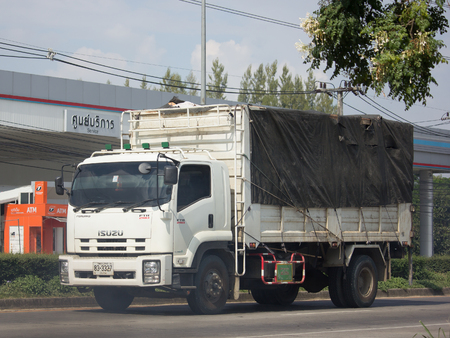CHIANG MAI, THAILAND -NOVEMBER 21 2017: Private Isuzu Cargo Truck. Photo at road no.1001 about 8 km from downtown Chiangmai, thailand. Editorial
