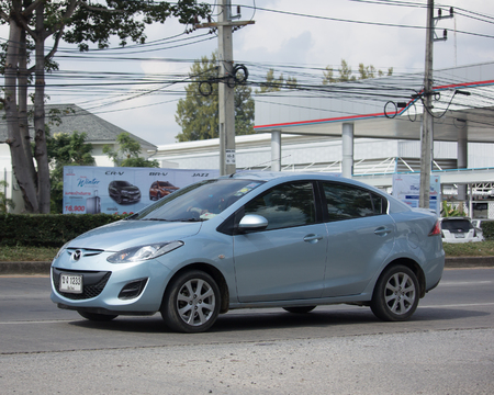 CHIANG MAI, THAILAND -NOVEMBER 28 2017: Private Eco car Mazda 2. On road no.1001 8 km from Chiangmai Business Area.
