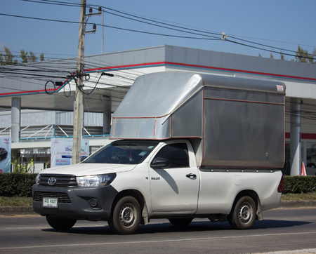 CHIANG MAI, THAILAND -NOVEMBER 30 2017: Private Pickup Truck Car Toyota Hilux Revo wtih Container. On road no.1001, 8 km from Chiangmai city.