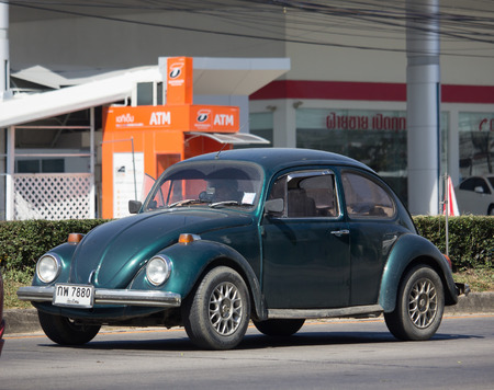 CHIANG MAI, THAILAND -NOVEMBER 30 2017:  Vintage Private Car, Yellow of Volkswagen beetle. Photo at road no.1001 about 8 km from downtown Chiangmai, thailand. Editorial