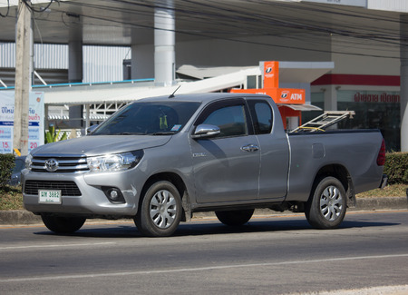 CHIANG MAI, THAILAND -DECEMBER 12 2017: Private Pickup Truck Car Toyota Hilux Revo. On road no.1001, 8 km from Chiangmai city. Editorial