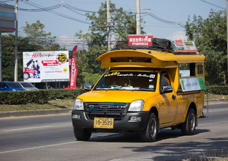 CHIANG MAI, THAILAND -DECEMBER 12 2017: Yellow mini truck taxi chiangmai, Service between city and Doisaket Subdistrict. Photo at road no 121 about 8 km from downtown Chiangmai, thailand. Sajtókép
