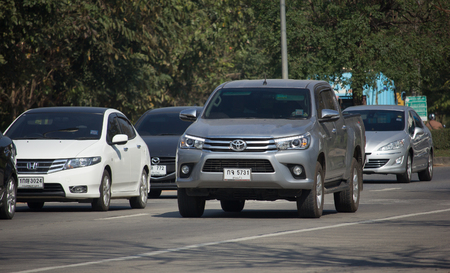 CHIANG MAI, THAILAND -JANUARY 9 2018:  Private Pickup Truck Car Toyota Hilux Revo. On road no.1001, 8 km from Chiangmai city.