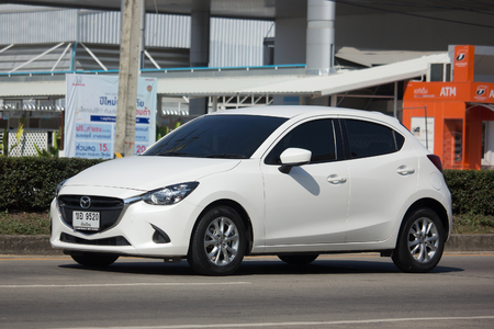 CHIANG MAI, THAILAND -JANUARY 9 2018: Private Eco car Mazda 2. On road no.1001 8 km from Chiangmai Business Area.