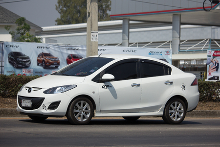 CHIANG MAI, THAILAND -FEBRUARY 27 2018: Private Eco car Mazda 2. On road no.1001 8 km from Chiangmai Business Area.