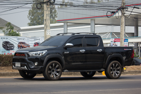 CHIANG MAI, THAILAND -MARCH 15 2018: Private Pickup Truck Car Toyota Hilux Revo. On road no.1001, 8 km from Chiangmai city.