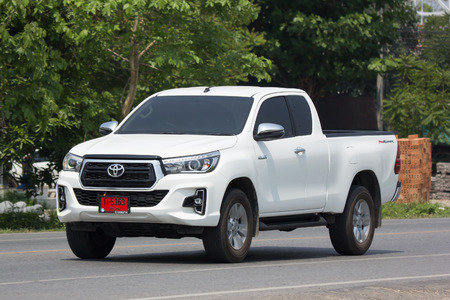 CHIANG MAI, THAILAND -DECEMBER 12 2017:  CHIANG MAI, THAILAND - APRIL 20 2018: Private Pickup Truck Car New Toyota Hilux Revo  Rocco. On road no.1001, 8 km from Chiangmai city.