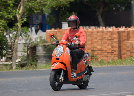 CHIANG MAI, THAILAND - APRIL  5 2018:  Private Honda Automatic Scooter Scoopy i Motorcycle. On road no.1001, 8 km from Chiangmai Business Area.