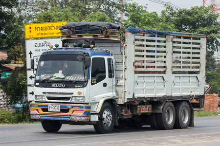 CHIANG MAI, THAILAND - APRIL 24 2018: Private  Isuzu  Cargo Truck. Photo at road no.1001 about 8 km from downtown Chiangmai, thailand.