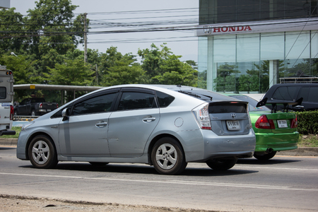 CHIANG MAI, THAILAND - MAY 10 2018:Private car Toyota Prius Hybrid System. On road no.1001 8 km from Chiangmai Business Area.