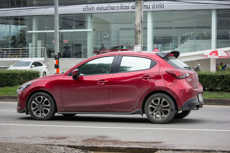 CHIANG MAI, THAILAND - JUNE 16 2018: Private Eco car Mazda 2. On road no.1001 8 km from Chiangmai Business Area.