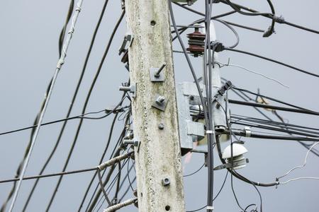 Closeup Eletricity line and electricity post wtih blue sky background Imagens