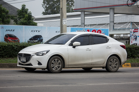 CHIANG MAI, THAILAND - JUNE 17 2018:  Private Eco car Mazda 2. On road no.1001 8 km from Chiangmai Business Area.