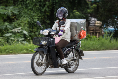 Chiangmai, Thailand - June 28 2018: Sale of Yakult Milk and Motorcycle on highway road. Photo on chiangmai city road. 에디토리얼