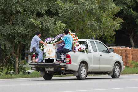 Chiangmai, Thailand - August  3 2018:  Funeral procession on highway road. Thai Lanna style. On city road of chiangmai. Redakční