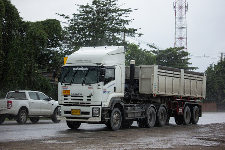 Chiangmai, Thailand - July  24 2018: Isuzu Trailer Dump truck on highway road. On road no.1001, 8 km from Chiangmai city.